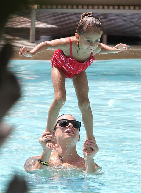 Jennifer Lopez Relaxes At The Pool With Her Kids And