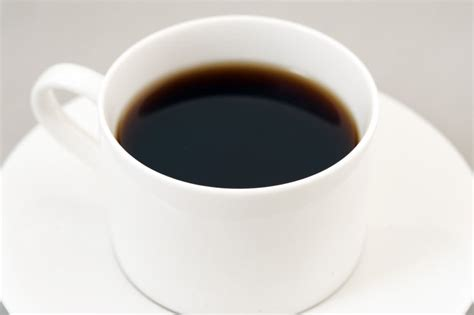 Black energizing coffee served in a white cup - Free Stock