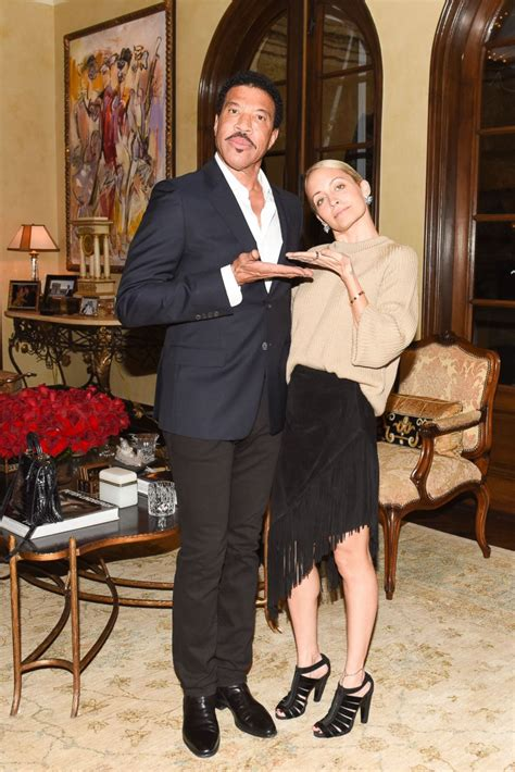 Lionel and Nicole Richie Pose at a Launch Party Picture