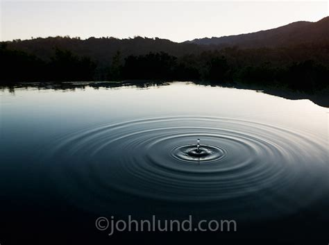 Water Drop Suspended Over A Lake